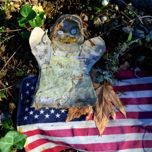 Fabric Puppet with marking Mansar Girl and American Flag, fallen off headstone