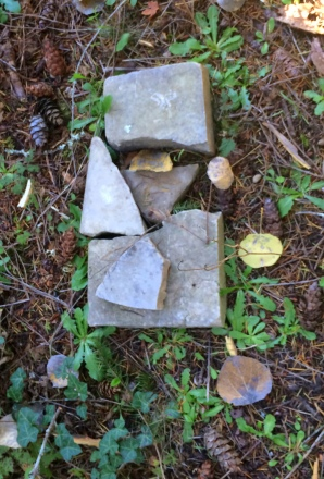 unmarked broken headstone